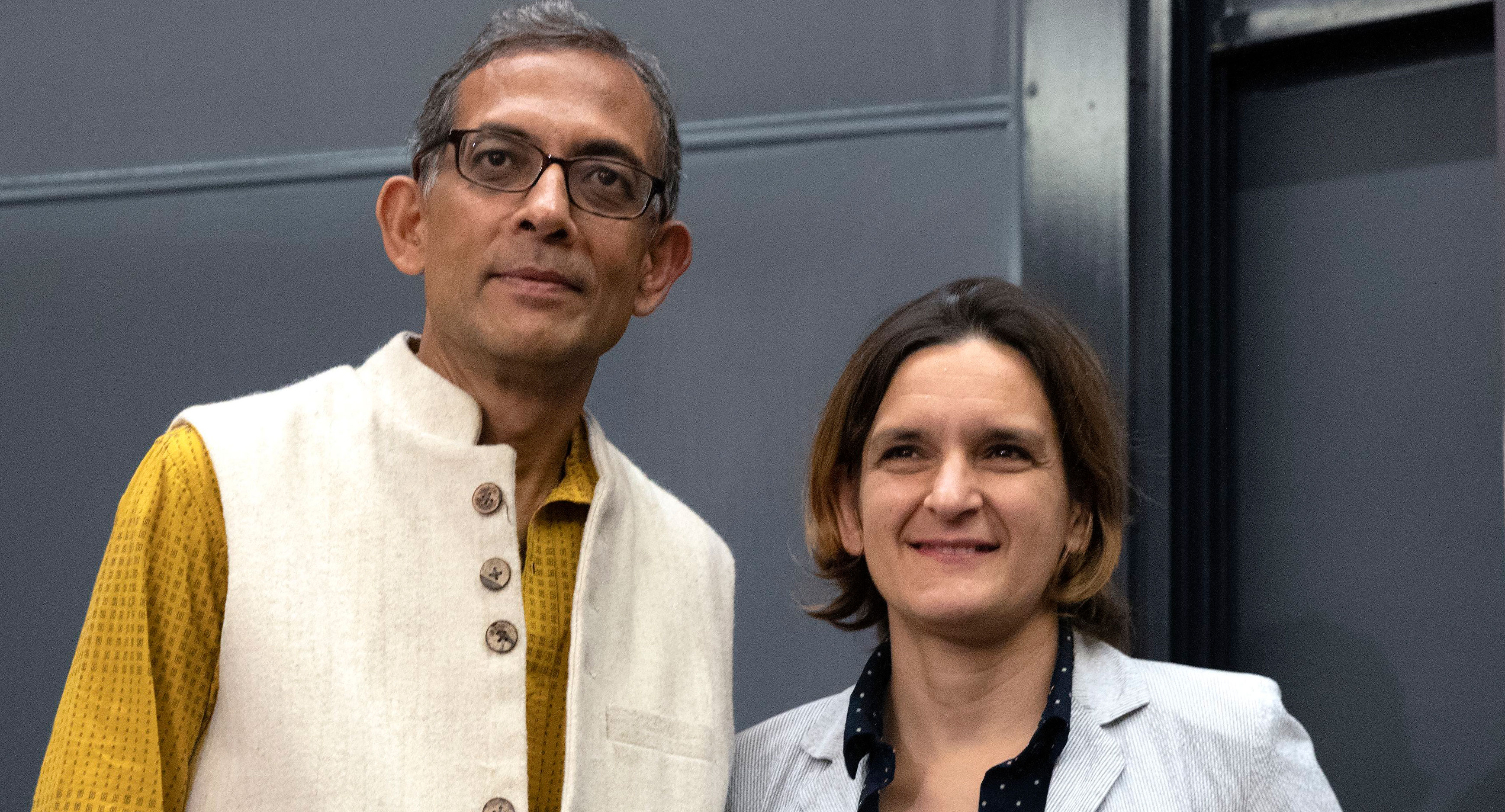 Abhijit Banerjee with Esther Duflo after a news conference at Massachusetts Institute of Technology in Cambridge on October 14, 2019