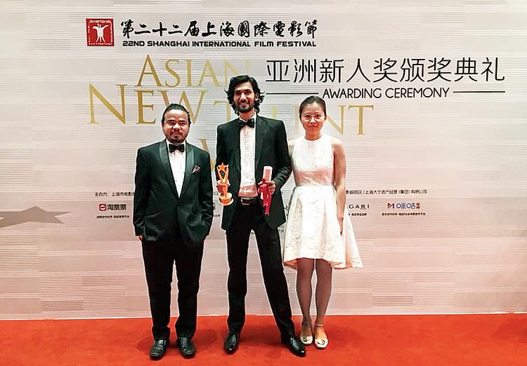 MA•AMA director Dominic Sangma and cinematographer Acharya Venu at the awards ceremony in Shanghai