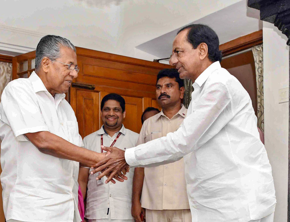 Telangana chief minister K. Chandrashekar Rao meets his Kerala counterpart Pinarayi Vijayan, at the latter's residence, in Thiruvananthapuram, Monday, May 6, 2019.