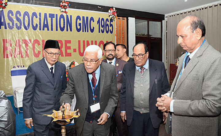 Dr Bhupen Deka lights the inaugural lamp at the reunion in Guwahati on Saturday.