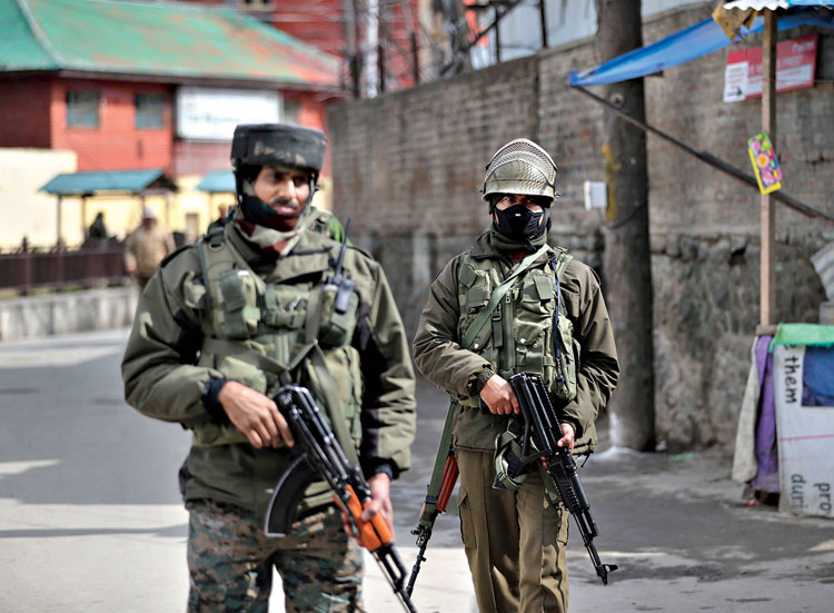 Paramilitary soldiers guard a market in Srinagar on March 8.