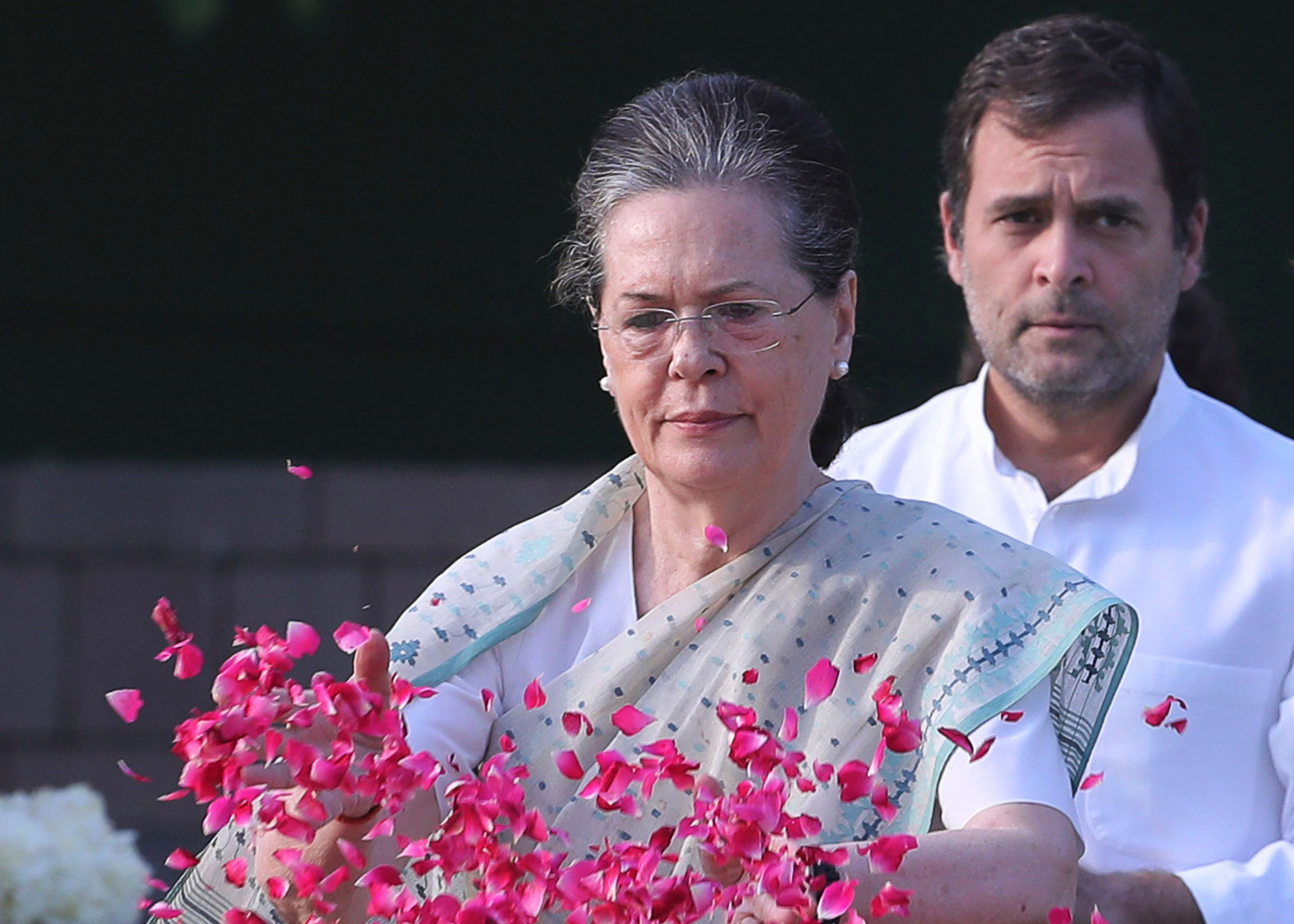 Sonia Gandhi, left, had led the Congress for 19 years before handing over the baton to her son Rahul Gandhi (right). Now she has returned as the interim party president.