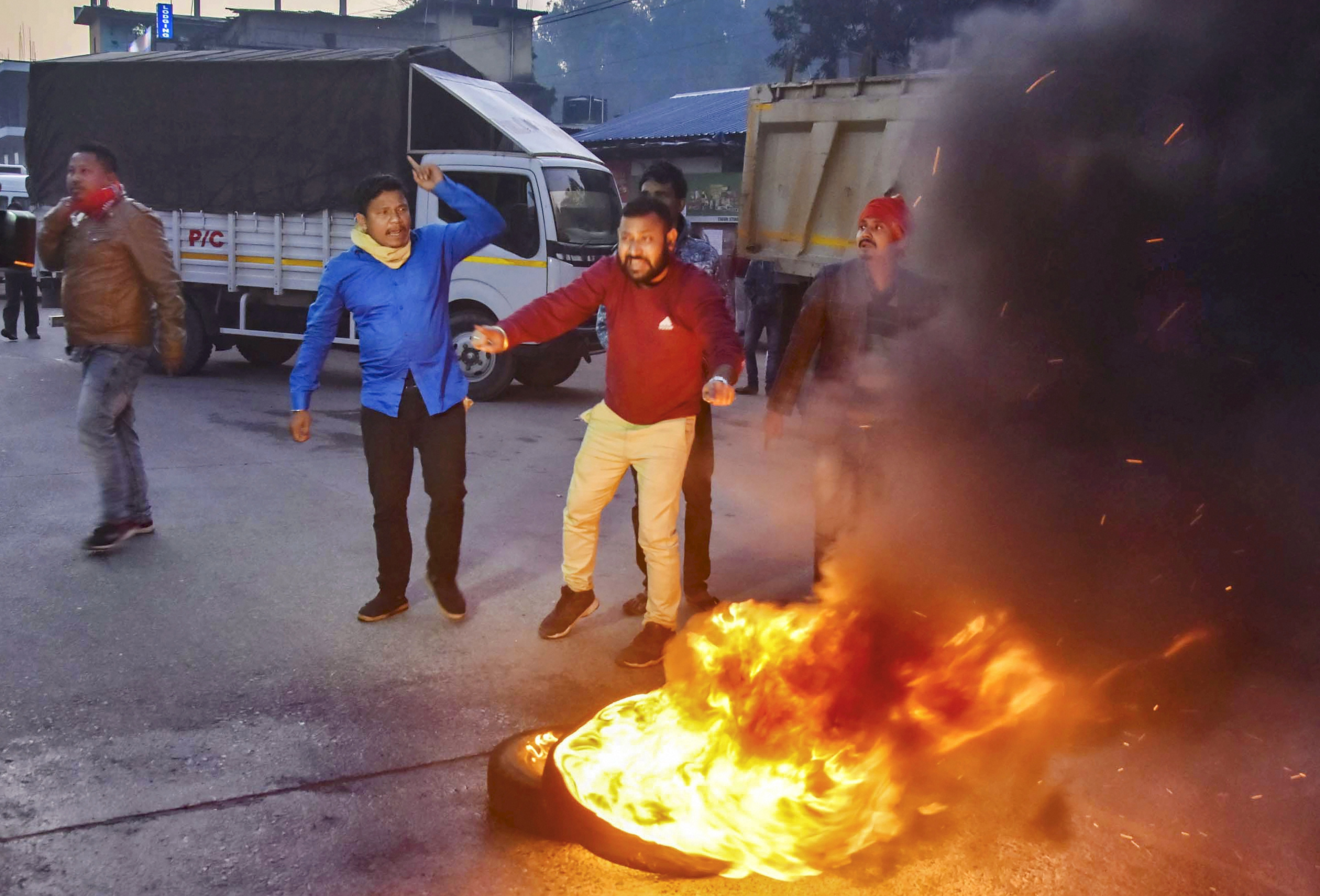 Protesters burn tires at a strike during Assam Bandh called by All Assam Chutia Students Union and All Moran Students Union against the Citizenship (Amendment) Bill, in Guwahati, Monday, December 9, 2019.