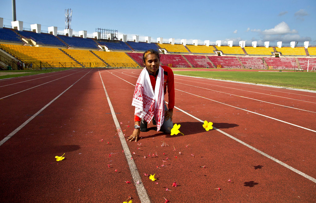 Indian athlete Hima Das offers prayers on a track at Indira Gandhi Athletics Stadium at the Sarusajai Sports Complex in Gauhati.