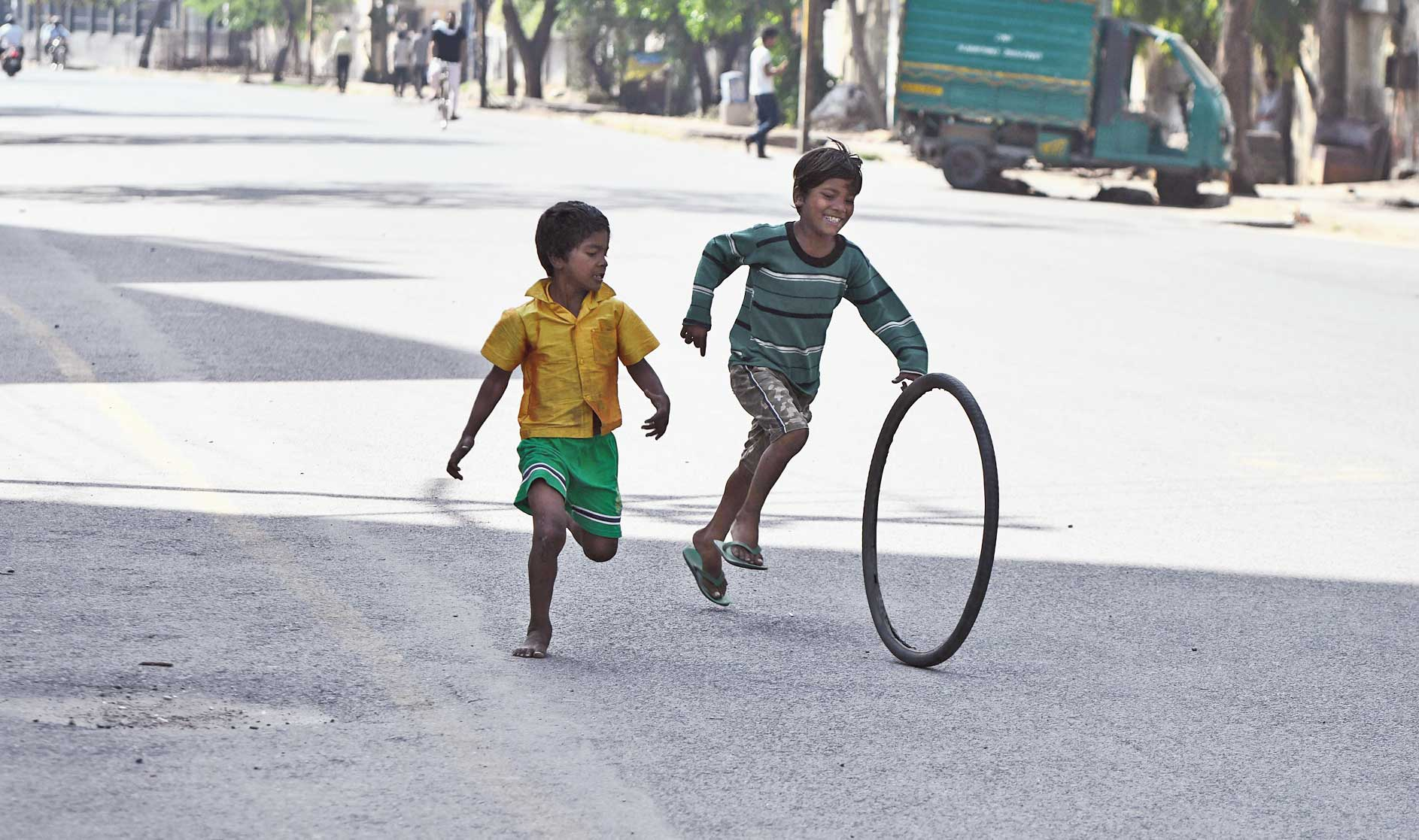 Children play on a deserted road in Noida during the lockdown on Tuesday.