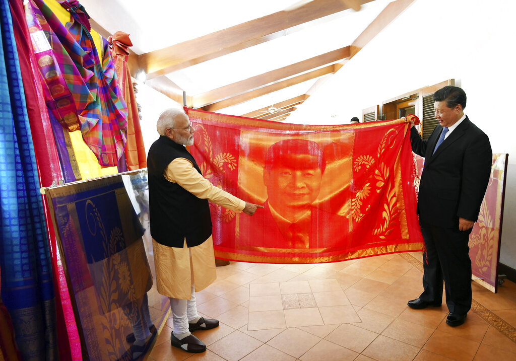 Prime Minister Narendra Modi and Chinese President Xi Jinping exchange gifts in Mahabalipuram