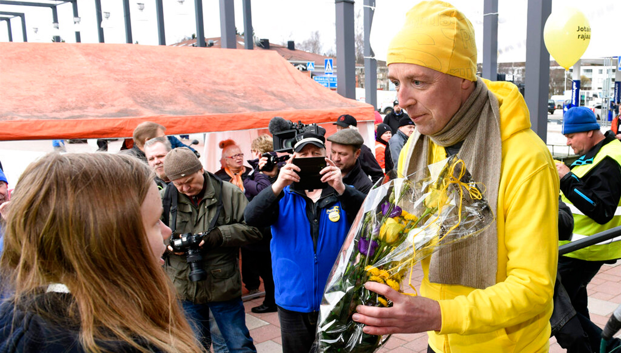 Chairman of the Finns Party Jussi Halla-aho, right, campaigns for the Finnish parliamentary elections in Tuusula, Finland on Saturday, April 13, 2019, a day ahead of the elections.