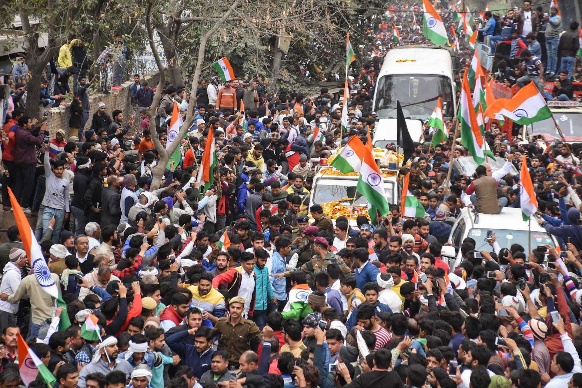 People gather in Faridabad on Wednesday, February 20, to pay their last tributes to army jawan Naik Sandeep Kaliraman, who died after succumbing to injuries sustained during the encounter with militants following the Pulwama terror attack