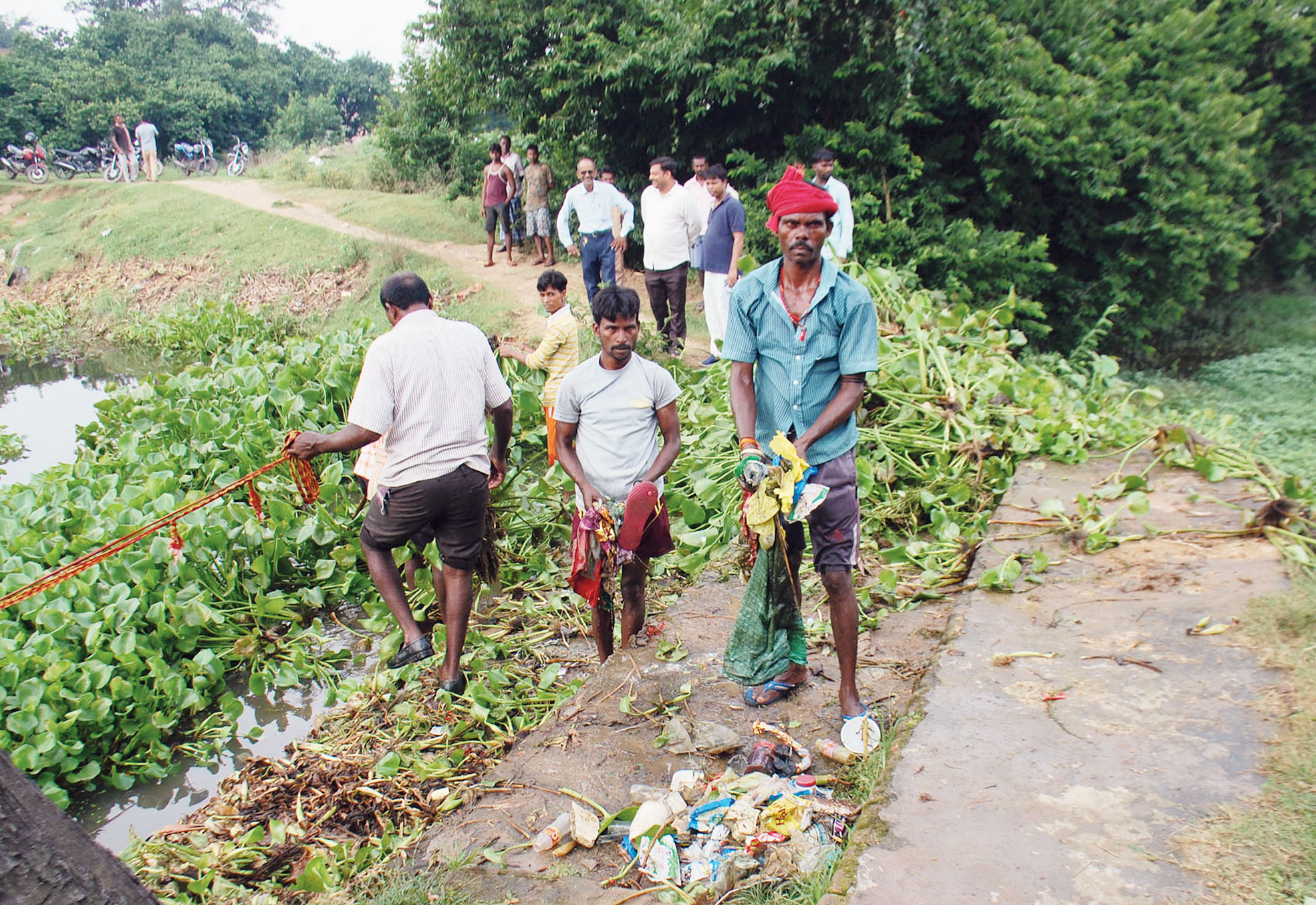 Municipal workers clean up Manjhi Talab in Dhanbad on Wednesday.