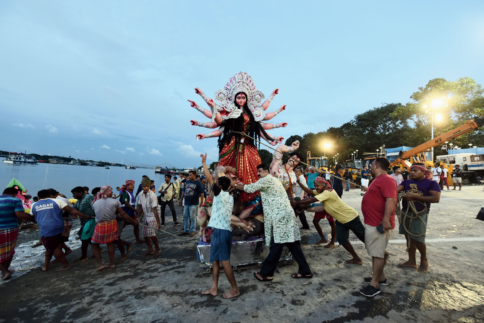 A Durga idol being taken to the Hooghly for immersion at Babughat on Dashami