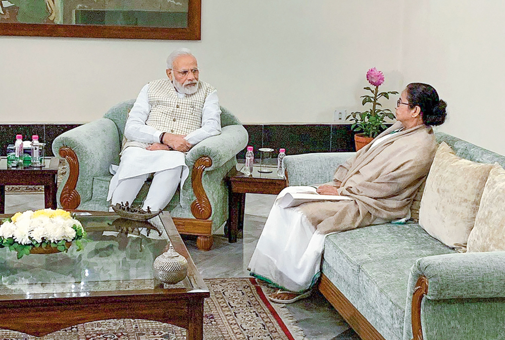 Narendra Modi with Mamata Banerjee during a meeting in Calcutta