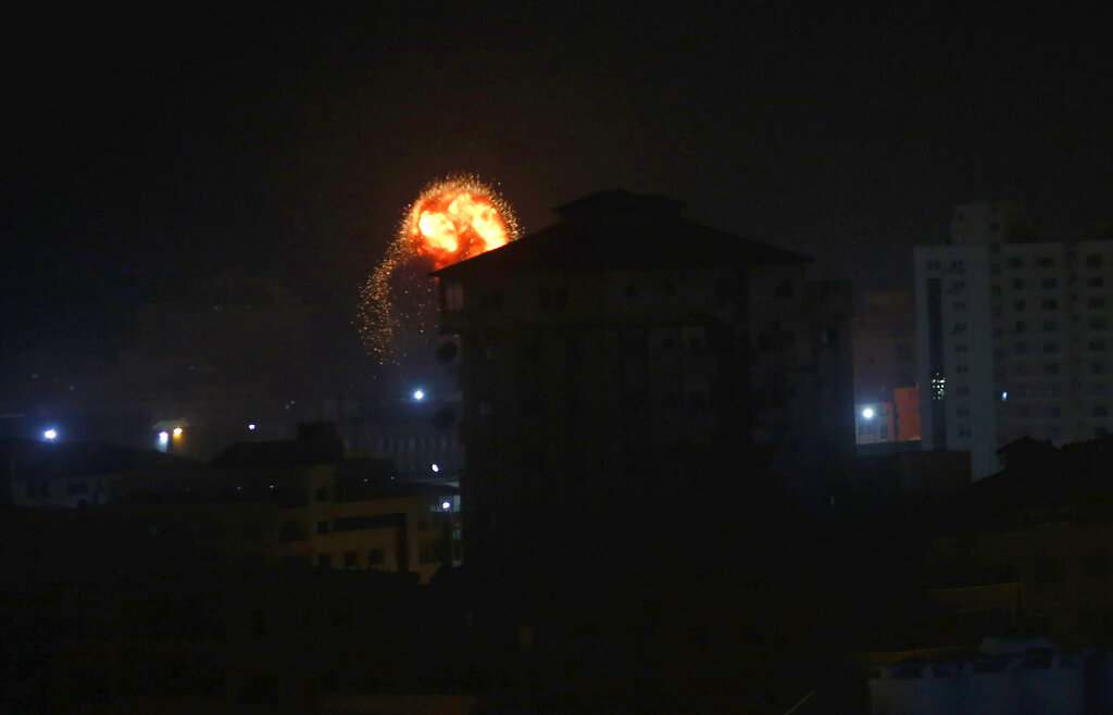 An explosion caused by Israeli airstrikes is seen on Gaza City early on Friday.