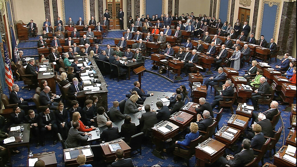 In this image from video, Senators vote on the first article of impeachment during the impeachment trial against President Donald Trump in the Senate at the US Capitol in Washington, Wednesday, February 5, 2020