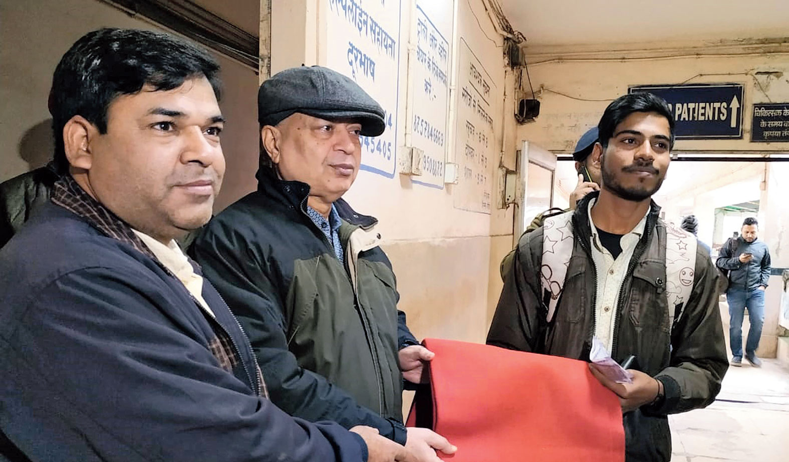 Officials give blankets at RIMS in Ranchi on Thursday.