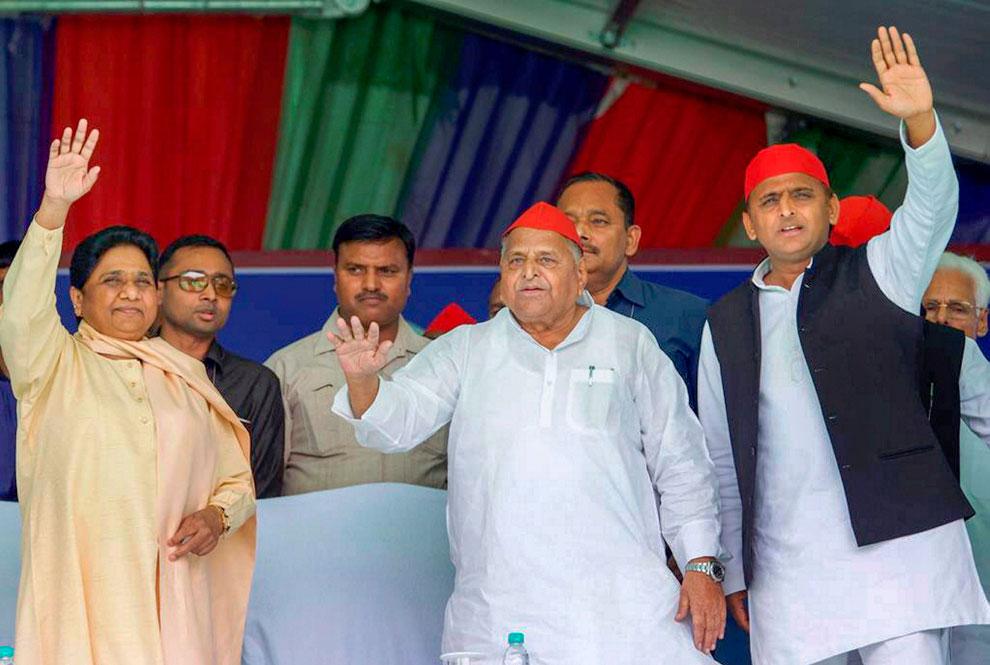 Samajwadi Party patron Mulayam Singh Yadav, his son and party President Akhilesh Yadav and Bahujan Samaj Party chief Mayawati wave at the crowd during their joint election campaign rally in Mainpuri, Friday, April 19, 2019.