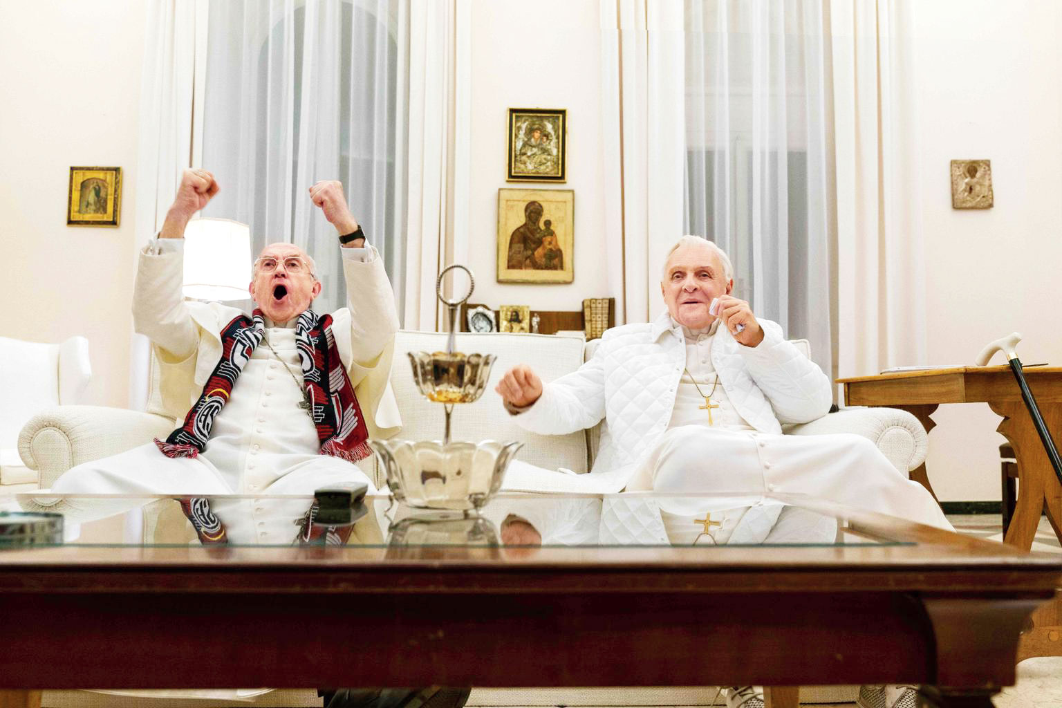 Jonathan Pryce and Anthony Hopkins in The Two Popes that releases in select theatres in November and streams on Netflix in December