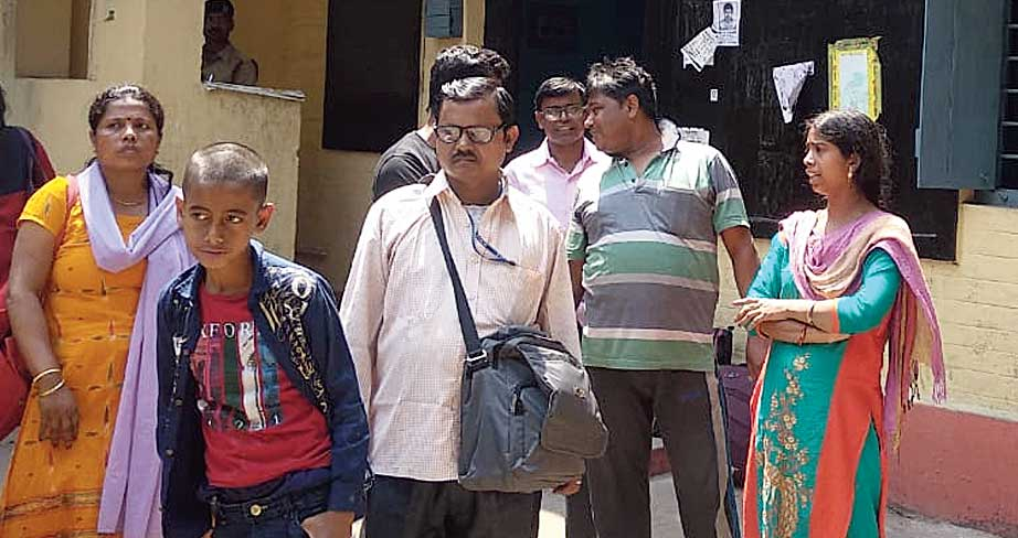 Some of the robbed passengers at the Burdwan railway station on Sunday.