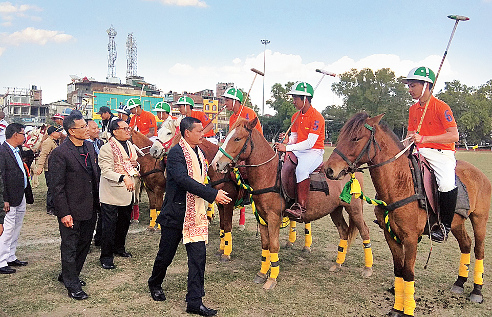 Titular king Leishemba Sanajaoba greets players at the polo tournament at Mapal Kangjeibung on Friday.