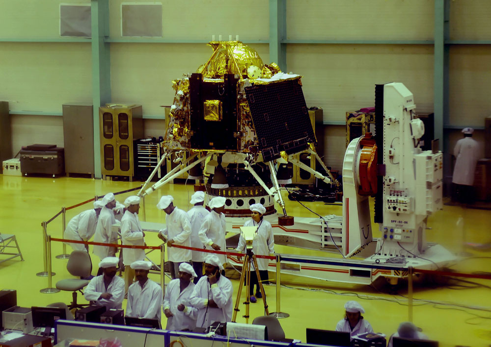 Isro personnel work on the orbiter vehicle of Chandrayaan-2, India's first moon lander and rover mission planned and developed by Isro at Isro Satellite Integration and test establishment (ISITE), in Bengaluru, Wednesday, June 12, 2019.