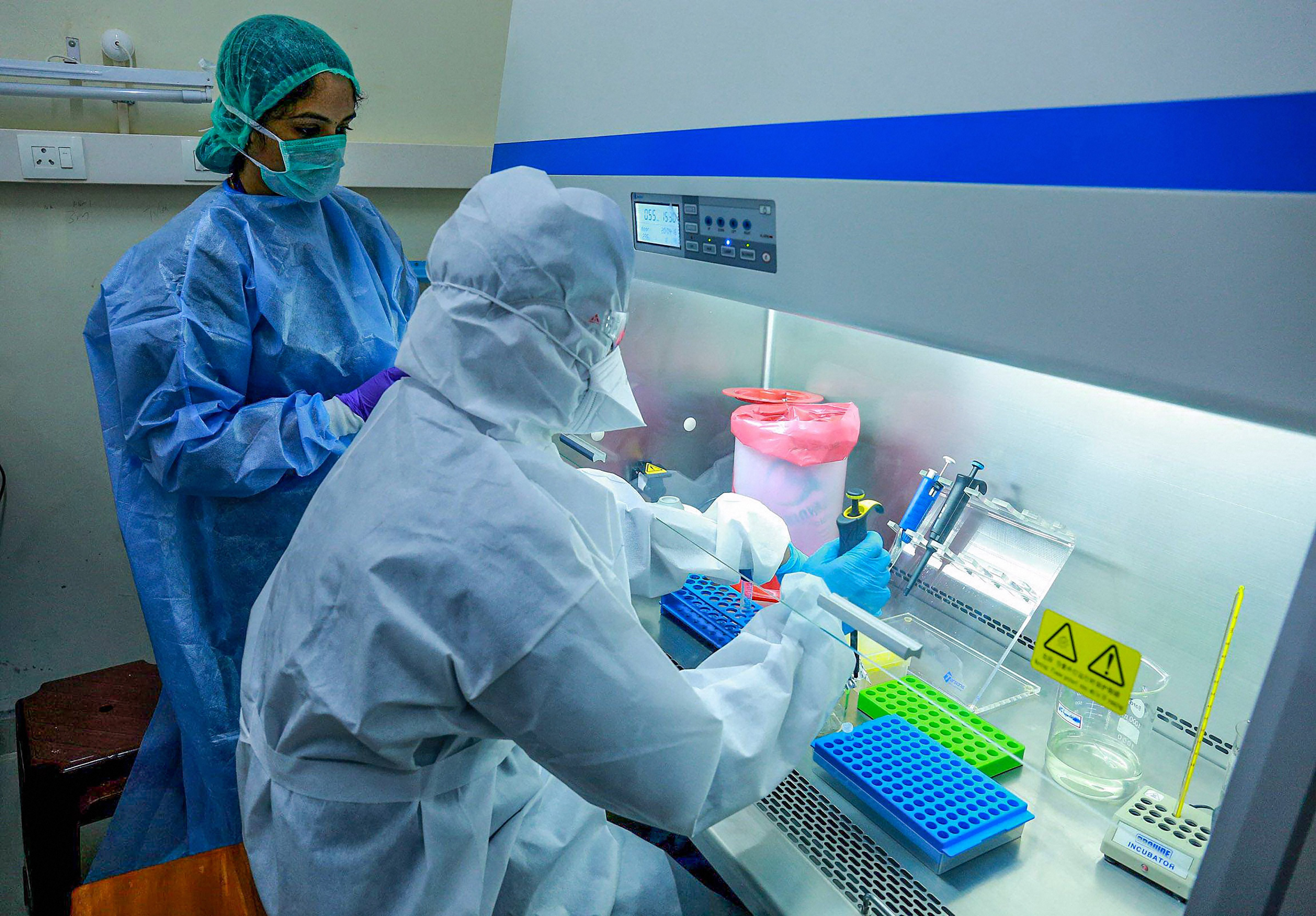 Medics at the real-time Polymerase Chain Reaction laboratory (PCR lab) at the Kalamassery Medical College Hospital, during the nationwide lockdown in wake of the coronavirus pandemic, in Kochi, Thursday, April 16, 2020.
