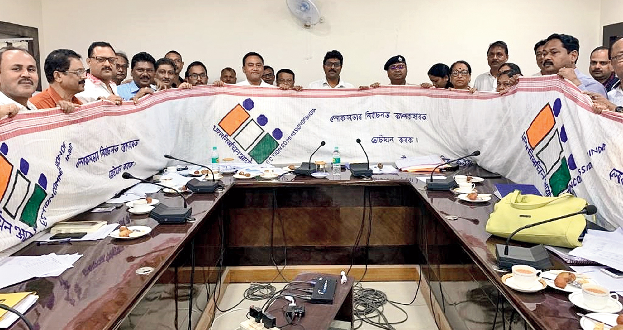 Election Commission observers unveil the gamosa in Nagaon.