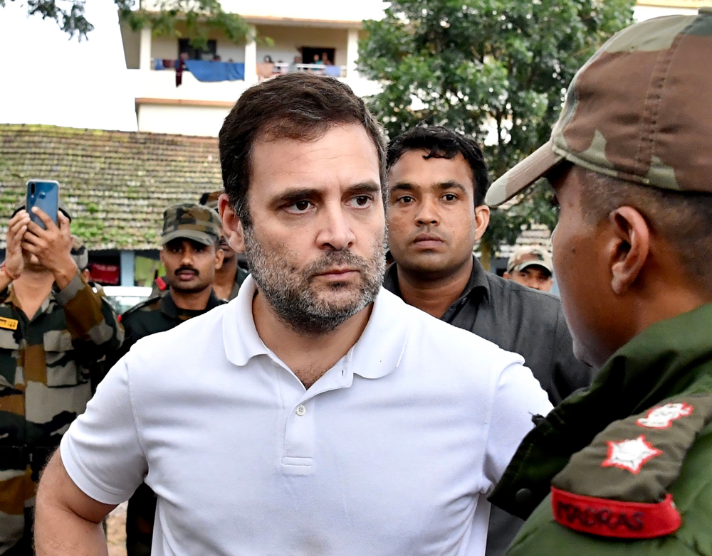Congress leader Rahul Gandhi interacts with army personnel involved in rescue and relief operations in the flood affected areas, in Wayanad district, Monday, August 12, 2019.