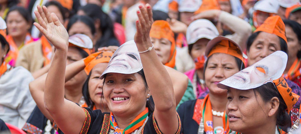 BJP supporters wearing caps and masks at a rally of Prime Minister Narendra Modi at Pasighat, Arunachal Pradesh, on Wednesday.