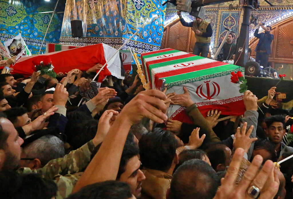 Mourners carry the coffins of Iran's top general Qassem Soleimani and Abu Mahdi al-Muhandis, deputy commander of Iran-backed militias in Iraq.