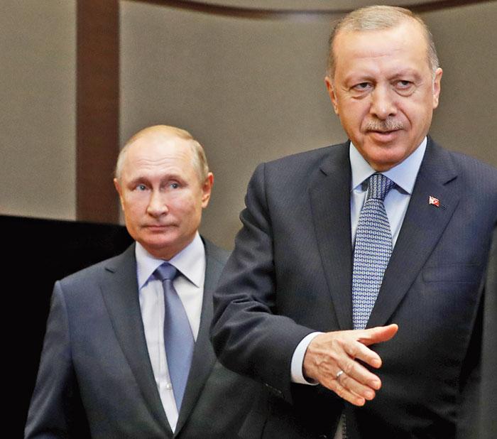 Russian President Vladimir Putin (left) with his Turkish counterpart Tayyip Erdogan  in Sochi, Russia, on Tuesday.