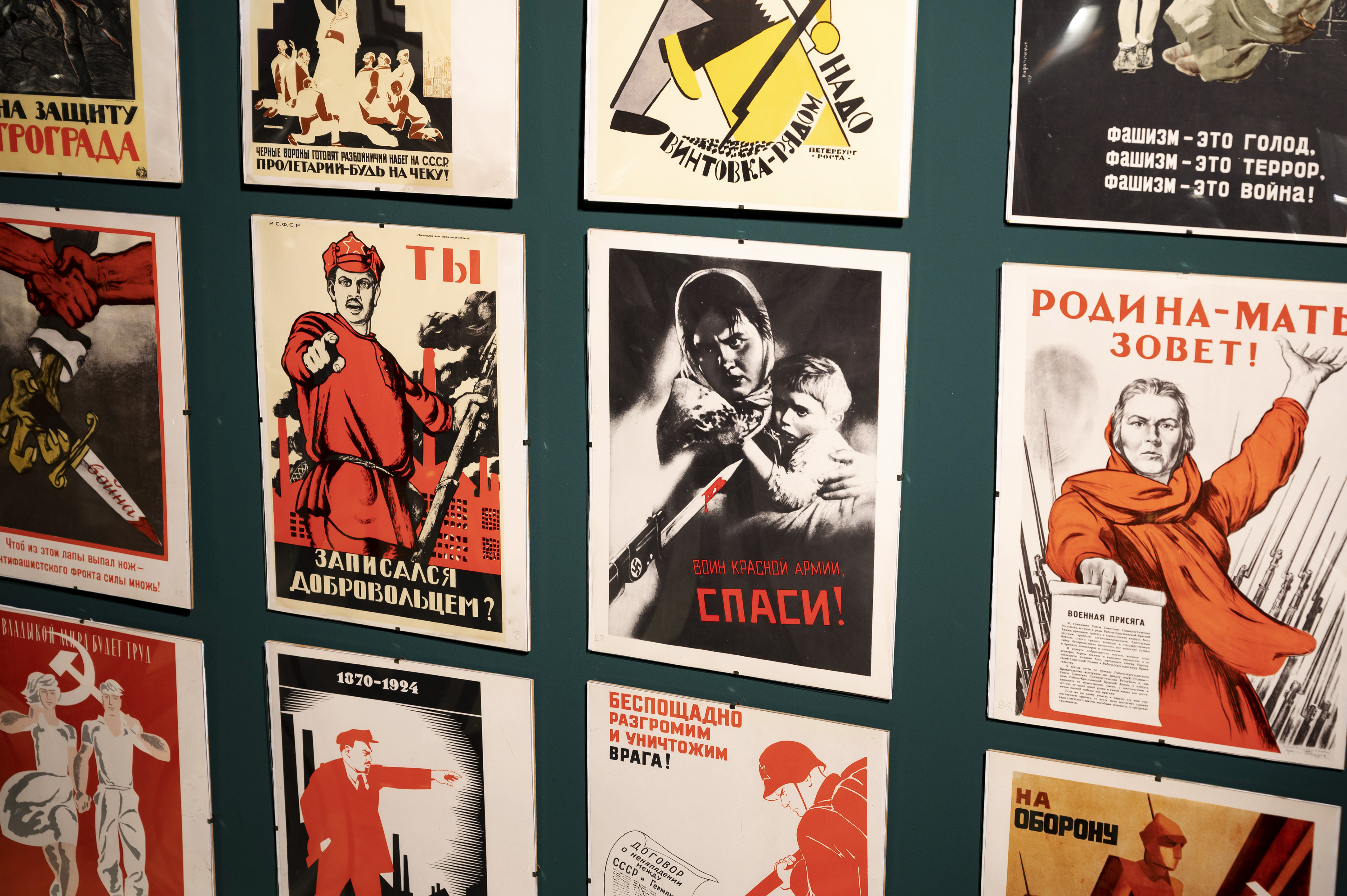 Soviet propaganda posters adorn a wall in the KGB Spy Museum.