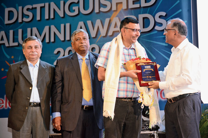 Anand Narasimhan, dean faculty and research at IMD, Lausanne, Switzerland, receives distinguished alumnus award (academician) from XLRI director Father P Christie in Jamshedpur on Saturday.