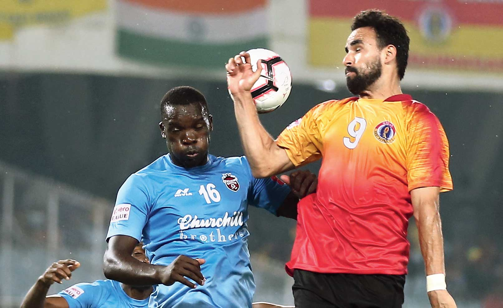 Khalid Aucho (left) and Enrique Esqueda in a tussle for the ball on Sunday.