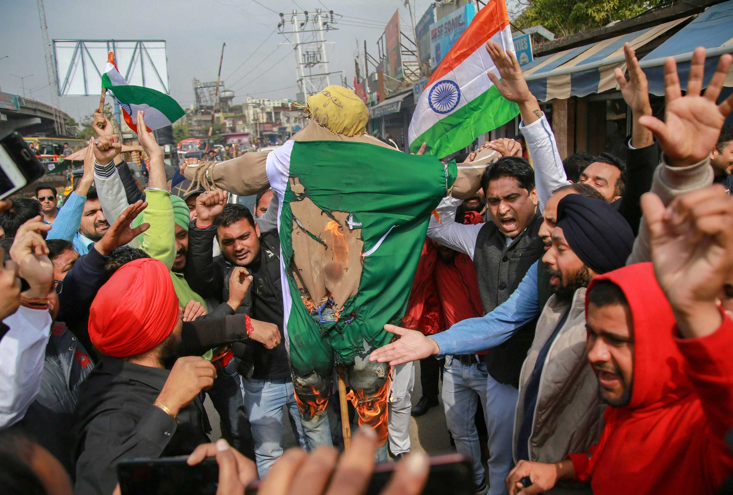 Jammu and Kashmir Pradesh Youth Congress members and supporters burn Pakistan Prime Minister Imran Khan's effigy as they protest against the Pulwama terror attack, in Jammu, on Saturday.