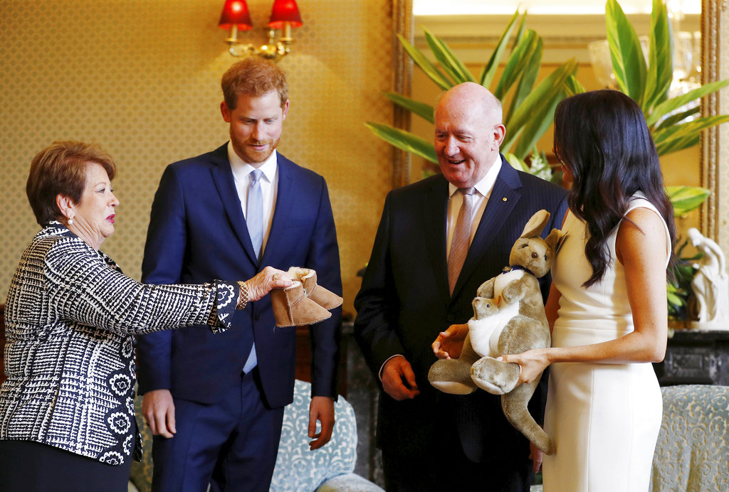 Harry and Meghan receive gifts from Australia's Governor General Sir Peter Cosgrove and his wife Lady Cosgrove at Admiralty House in Sydney.