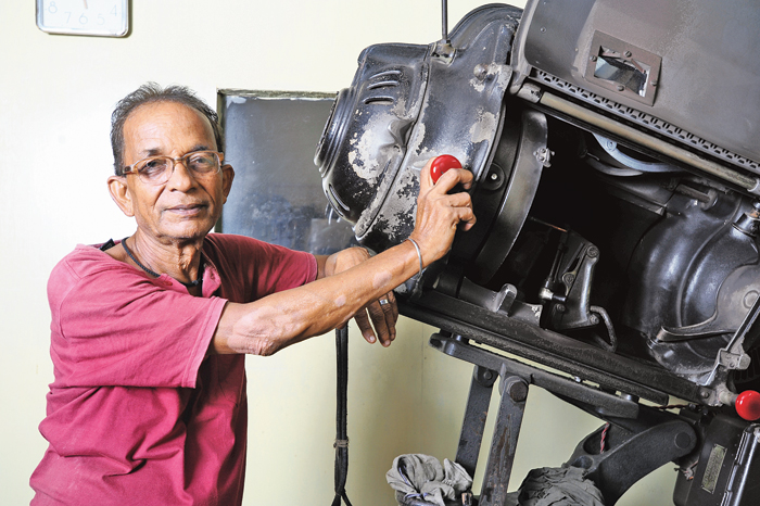 Sukumar Ghosh with one of the three projectors