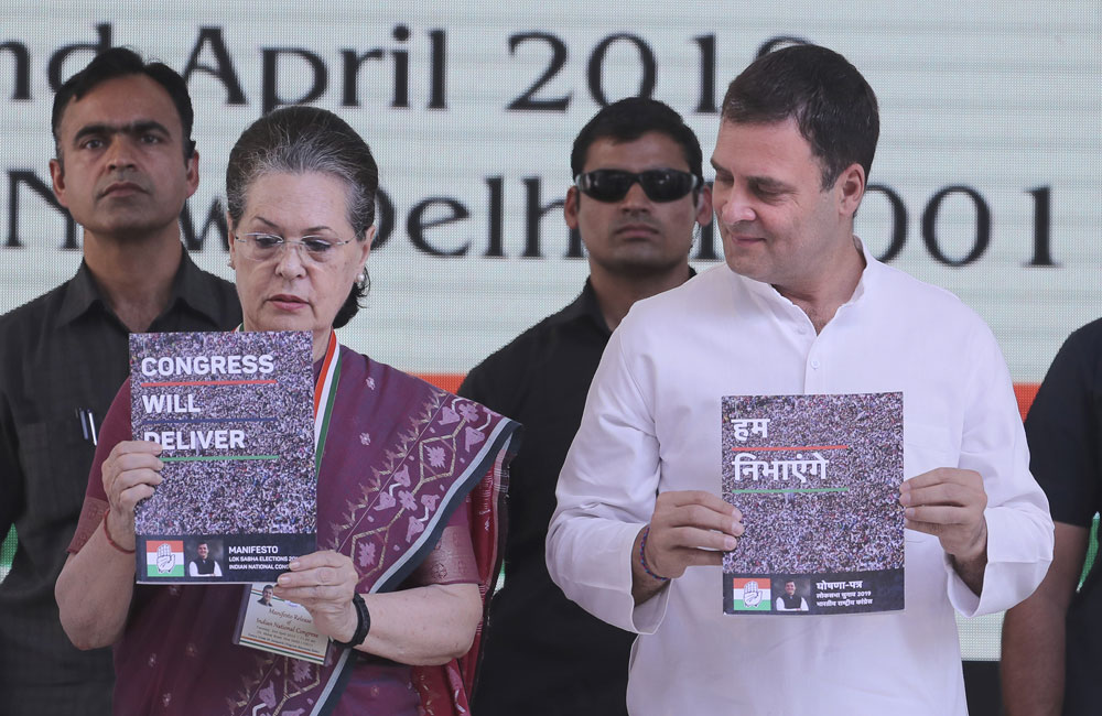 Sonia Gandhi, left, and Congress Party President Rahul Gandhi, right, release the Congress manifesto for the upcoming general elections, in New Delhi on Tuesday, April 2, 2019.