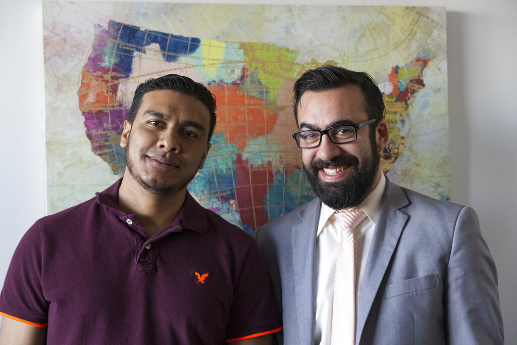 In this January 6, 2020, photo, Michael Navas Gomez (left) poses for a photo with his attorney, Joshua Greer at his office in Los Angeles. Navas Gomez, who was detained in a remote detention facility in Louisiana for five months, was lucky to have a lawyer who helped him navigate the immigration court system.