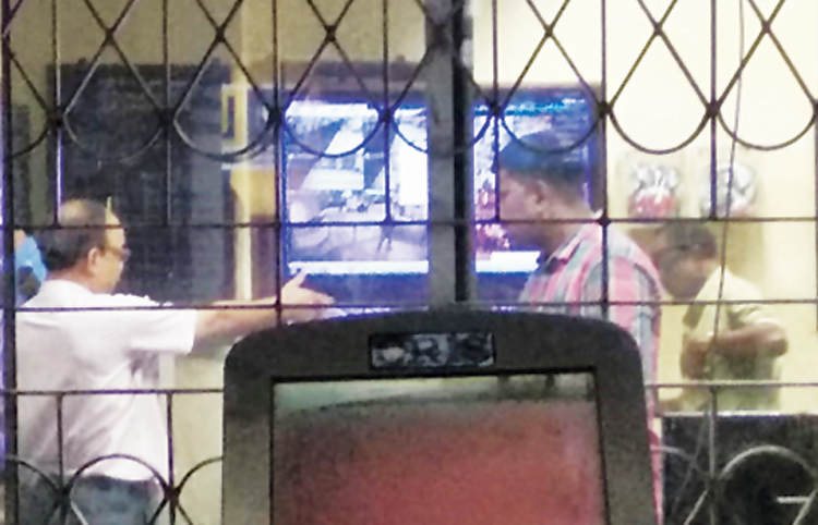 An official at Park Street Metro station shows CCTV footage to the passenger to explain to him what he had done when he claimed that he had been brought to the room for no reason.