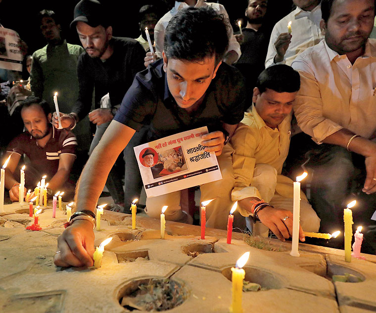Activists of the Congress party's youth wing light candles at a vigil in Delhi for environmental activist G D Agrawal, who died on October 11