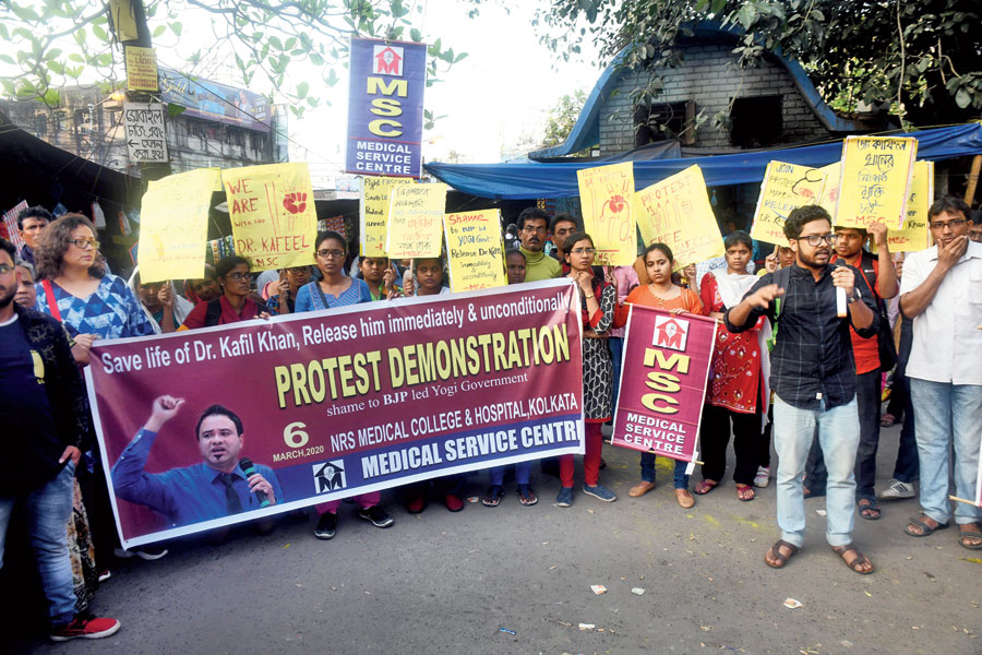 Doctors demand the release of Kafeel Khan in front of NRS hospital on Friday.