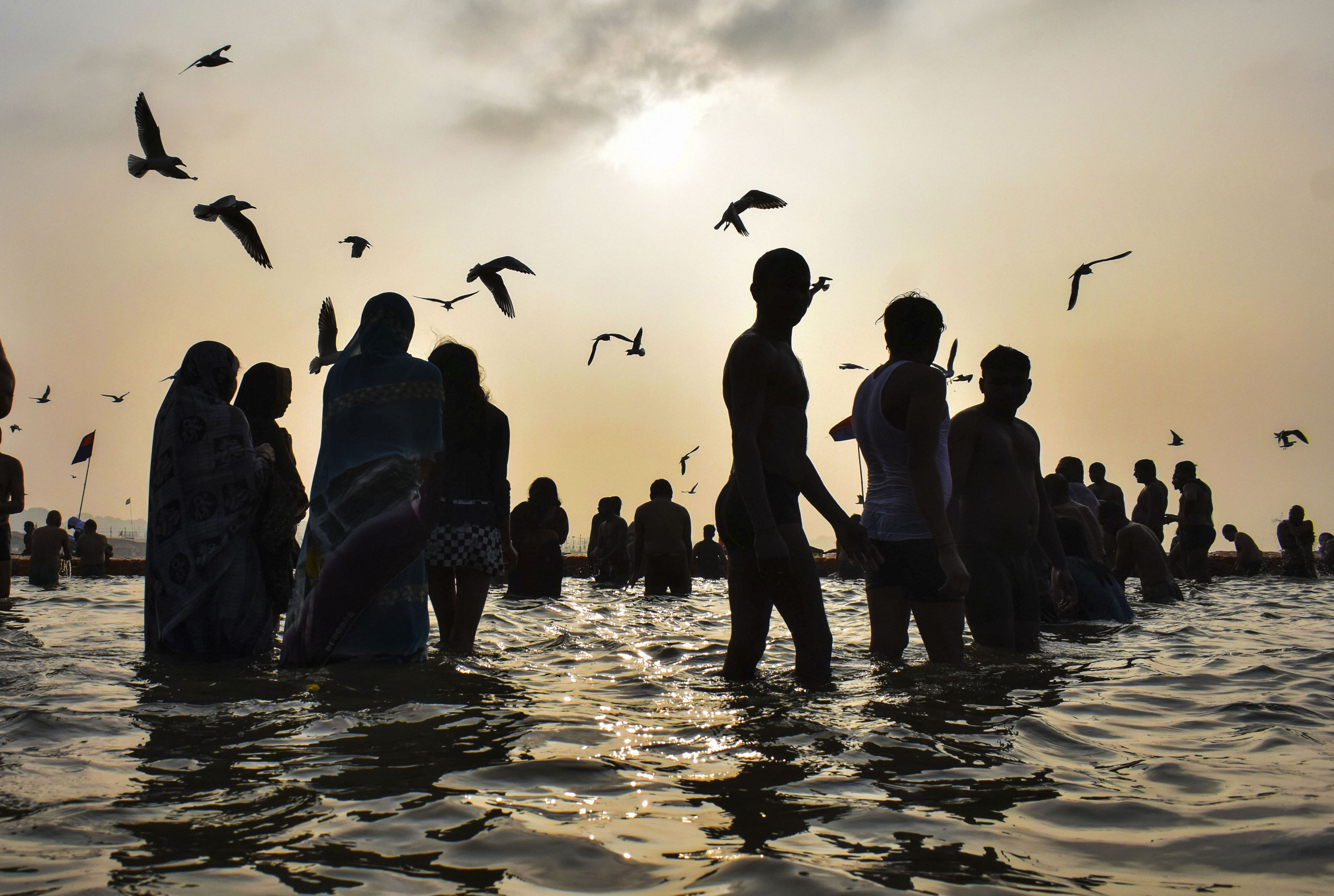 Devotees gather at Sangam to take a holy dip on the occasion of Basant Panchami during the ongoing Magh Mela in Prayagraj, Thursday
