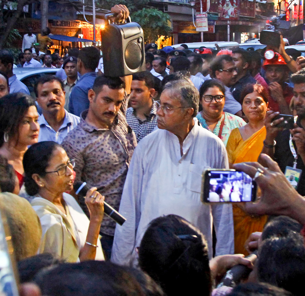 West Bengal Chief Minister Mamata Banerjee interacts with residents of Bowbazar area, where several houses have been damaged owing to a tunnel boring for East-West Metro corridor, in Calcutta on Monday, September 2, 2019.