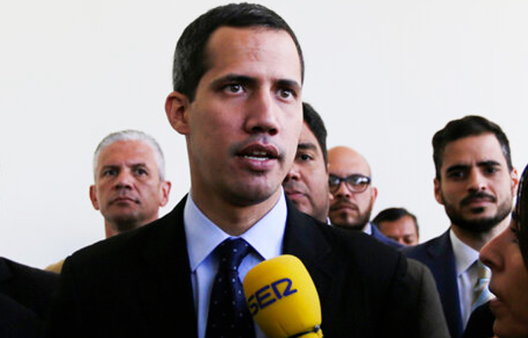 Opposition National Assembly President Juan Guaido, who declared himself interim president of Venezuela, speaks with the media upon his arrival to National Assembly in Caracas, Venezuela on Tuesday, Jan. 29, 2019.