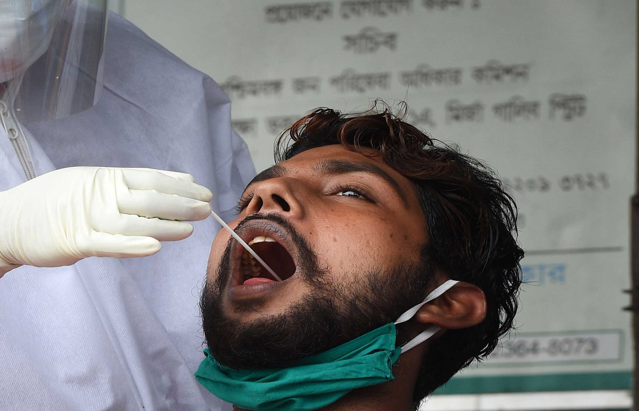 A medic collects swab sample of a man for Covid-19 test in Calcutta. The test rate per million people is 698 now, nearly four times the 183 recorded two weeks ago.