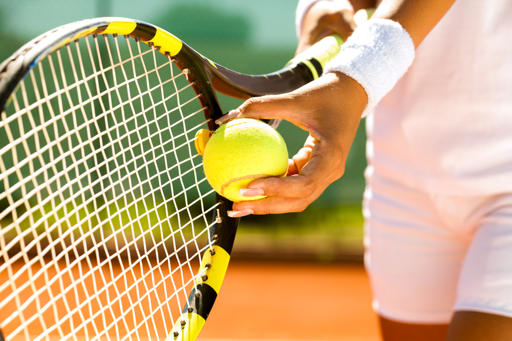 There the two young tennis players lofted shots over the guard rails and the road, running round not only their backhands but also boiler vents as the ball bounced, not on the clay they are used to but on concrete slabs.