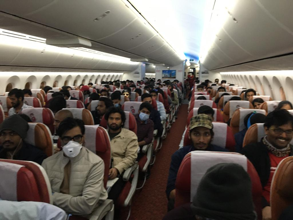 Stranded Indians in an Air India flight en route to New Delhi on Sunday, March 15, 2020
