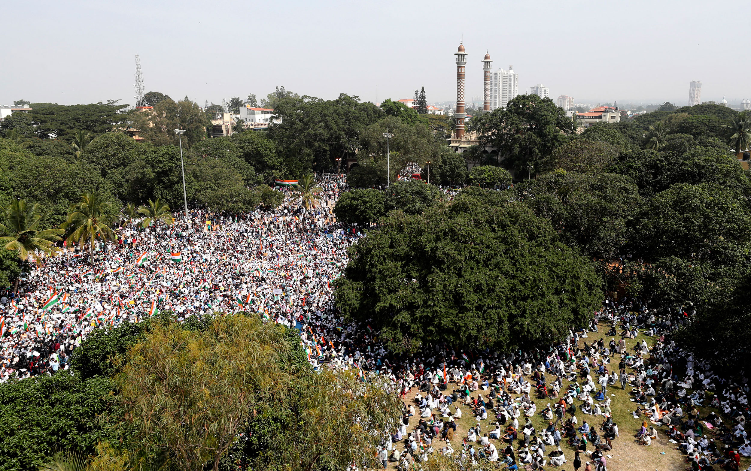 Citizens hold national flags and placards during a protest against the amended citizenship act in Bangalore on Monday.
