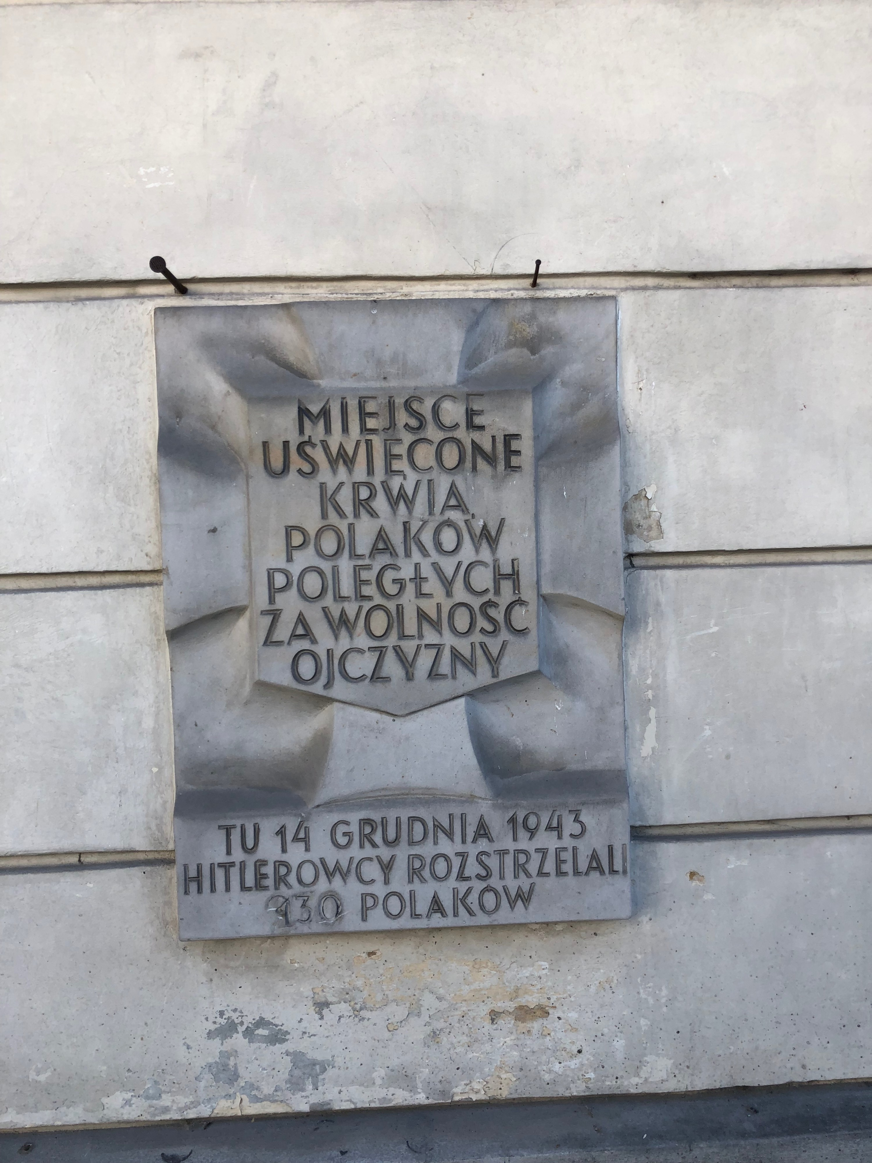 Across the city there are placards that mark the spot where a large number of Poles were shot dead by the Nazis