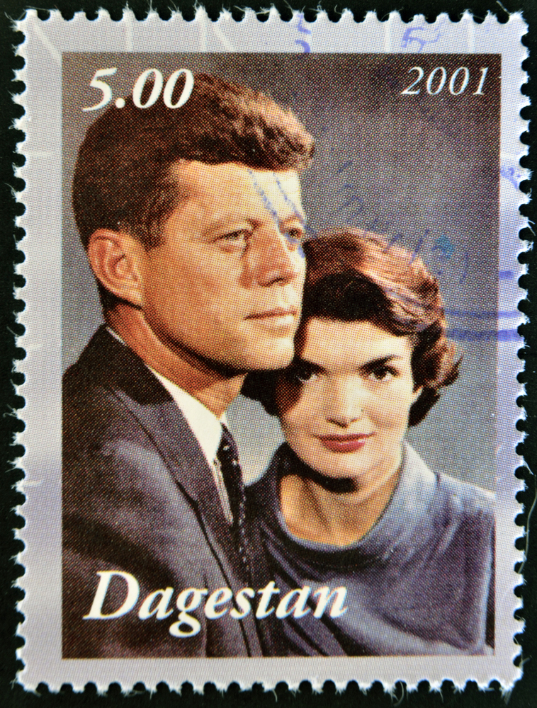 Kennedy was part of a motorcade along with his wife, Jacqueline, on the streets of Dallas when he was shot at by Oswald from atop  a nearby building.