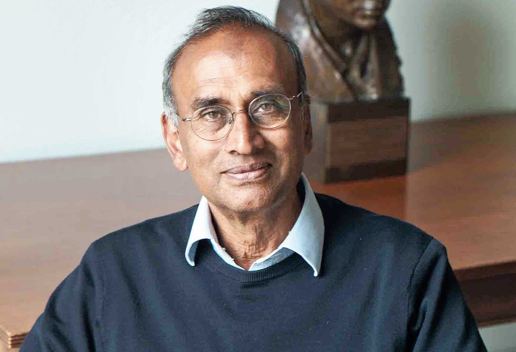Venkatraman Ramakrishnan at the Royal Society with a bust of Srinivasa Ramanujan in the background.